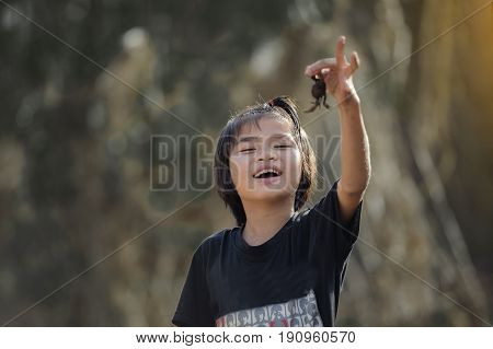 Happy asian child playing together on playground.
