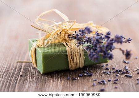 Handmade soap on wooden table with empty space