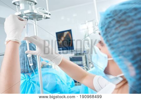 Close up shot of a nurse preparing for surgery at the operating theatre of the hospital copyspace doctor assistance assistant helpful profession occupation healthcare medicine.