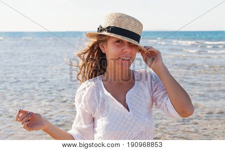A Young Woman In A Straw Hat, Fervently Laughing Against The Background Of The Sea, A Large Portrait