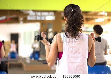 Beautiful pregnant woman at the gym in maternity yoga class.