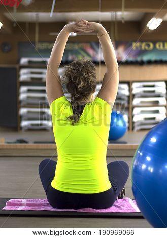 Beautiful women in pregnant prenatal fitness class.