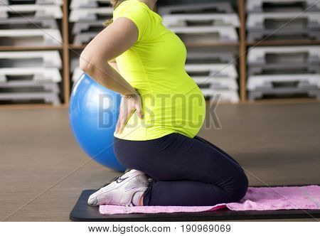 Future mother on prenatal yoga fitness class.