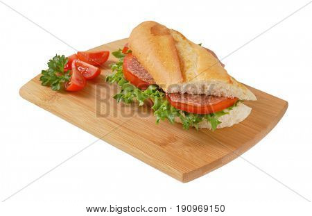 French loaf sandwich with salami on wooden cutting board