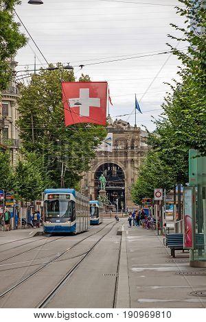 Zurich Shopping Street Bahnhofstrasse With Tram And Swiss Flag