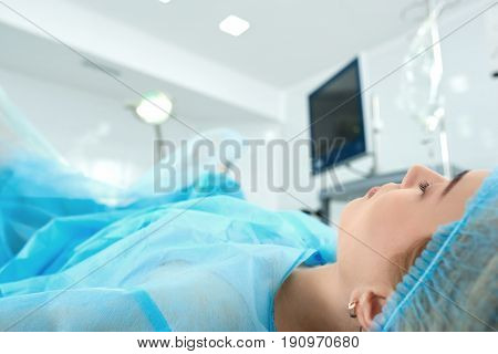 Cropped close up of a woman lying in operating theatre during surgery copyspace patient anesthetic asleep sleeping healthcare sterile surgical medical medicine clinical concept.