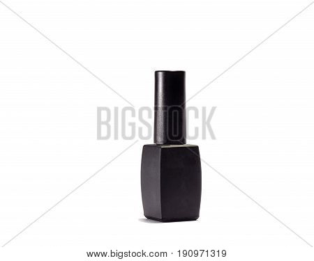 Black bottle of nail polish on a white background deployed half a turn