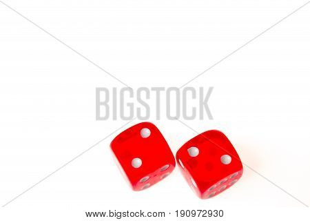 Two red dice both showing a two on the upper face isolated against a white background