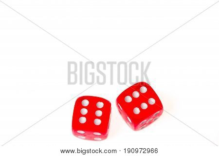 Two red dice both showing a six isolated agaist a white background
