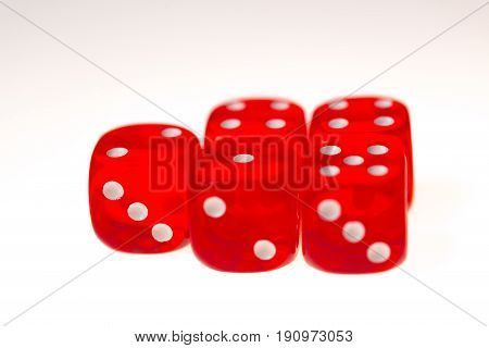 Five red dice isolated against a white background