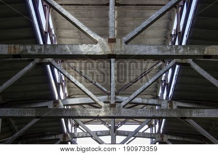 Cement beams inside an old building on the roof