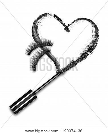 Close-up of mascara brush with black stroke in the shape of heart and false eyelashes