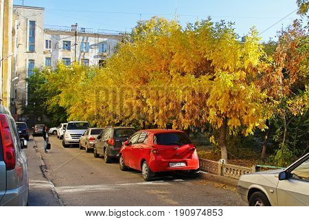 Volgograd Russia - October 11 2014: Modern cars in autumn yard in Volgograd