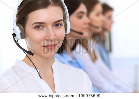 Call center operator.Young beautiful business woman in headset