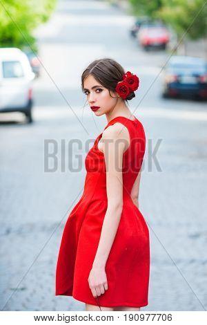 Woman In Stylish, Red Dress Walking On Road