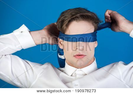 Blindfolded Man With Tie On Eyes In White Shirt