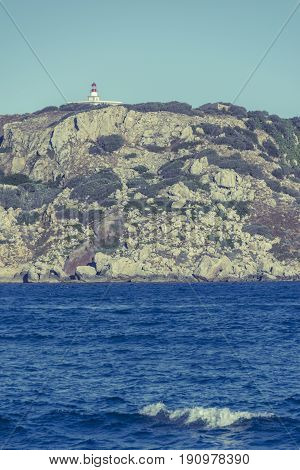Lighthouse on Medes islands, Girona, Catalonia. Vintage look image