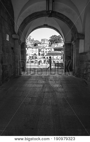 Trujillo Spain - June 4 2017: View of Plaza Mayor at Trujillo from the arch Spain. Granite fountain in the middle