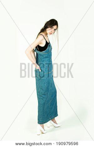 Girl With Long Brunette Hair In Long Jeans Denim Dress