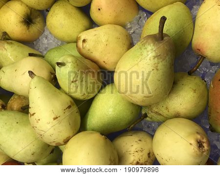 Pears. Background from fresh pears. Fruit background. Fresh organic pears. Healthy food background closeup