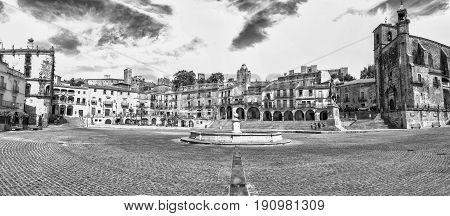 Trujillo Spain - June 4 2017: Panoramic view of Plaza Mayor at Trujillo Spain. Granite fountain in the middle
