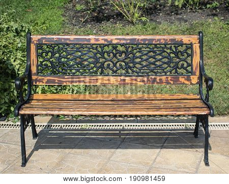 modern wooden benches in the summer garden in a sunny day