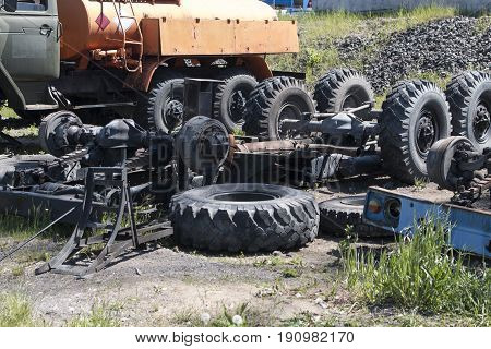 Dismantled old truck lying on the ground in a dump