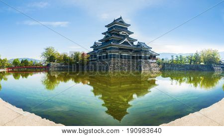 Matsumoto castle with reflection in water National treasure of Japan