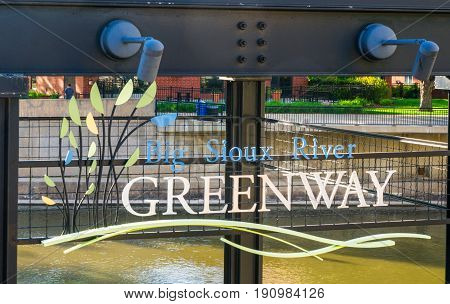 SIOUX FALLS SD/USA JUNE 3 2017: The Big Sioux River Recreation Trail and Greenway entrance sign.