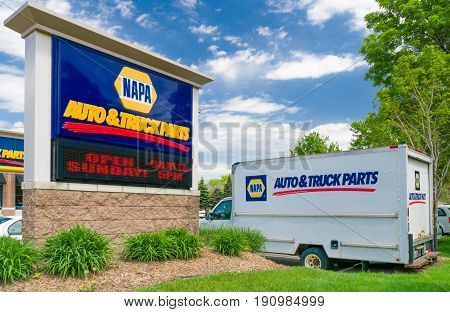 HASTINGS MN/USA - MAY 14 2017: Napa Auto Care sign and truck. NAPA is an auto parts company in the United States.