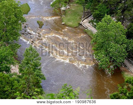 Dirty waters flowing in a river  Clear rivers turned muddy following rains in the mountains
