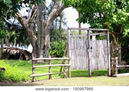 Wooden and bamboo gate  A gate made of bamboo and wood in a village in the island of Guam