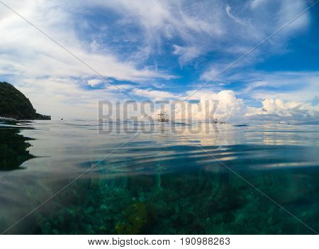 Sky and sea natural background. Double landscape water and sky photo. Seaside image. Above and below waterline. White fluffy cloud card. Ocean ripple. Seawater closeup. Banner template with text place