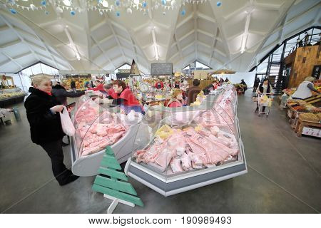 MOSCOW - JAN 19, 2017: Buyers and sellers at counters with meat on the Danilovsky Market in Moscow