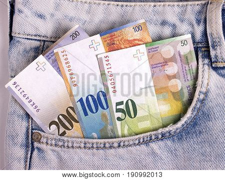 Closeup Of The Swiss Notes In The Jeans Pocket.