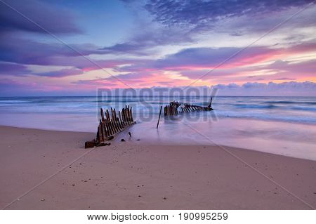 Sunrise at the Dick Beach shipwreck at Dicky Beach (Caloundra) on the Sunshine Coast in Queensland, Australia