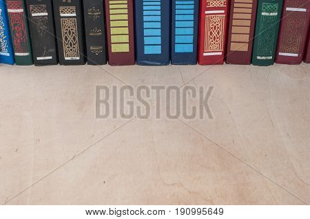 Row Of Colorful Books On A Shelf.
