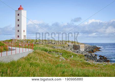 Picturesque lighthouse Kjølnes near Berlevåg, Finnmark, Norway