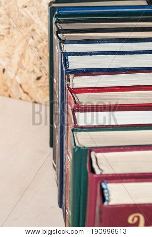 A Number Of Colorful Hardcovers On A Wooden Background