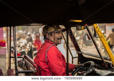 Portrait of a Tuktuk driver in Jaipur, Rajasthan, India