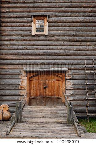 Log houses of the window and door