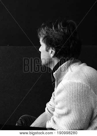 Composition of a man having watching away. Black and white picture.