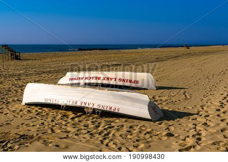 Spring Lake NJ USA -- June 12 2017 Spring Lake Beach Patrol Boats lie resting on the beach on a beautiful summer morning. Editorial Use Only.