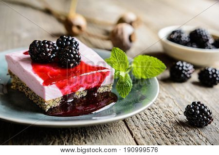 Delicious Poppy Seed And Blackberry Cheesecake Topped With Blackberry Sauce