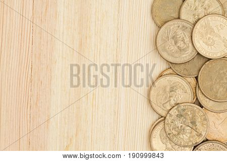 Gold coin money background USA gold one dollar coins on a wood desk with copy space