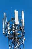 Technology on the top of the telecommunication GSM. Masts for mobile phone signal. Tower with antennas of cellular communication on the background of blue sky. poster