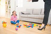 business woman back from office and see her daughter play toys messy up the living room feel angry and criticize the sadness asian kid girl at home. poster