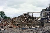 Destroyed the factory building and the road as after shelling. The mountain of debris poster