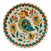 Covered with glaze ceramic plate handmade. Drawing on a plate - the cock. Painting in the technique Kosovo ceramics - it really authentic Ukrainian technique of painting on clay. Isolated on a white background poster