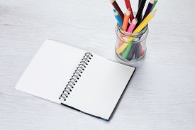 Blank Open Notebook With Pencil Crayons